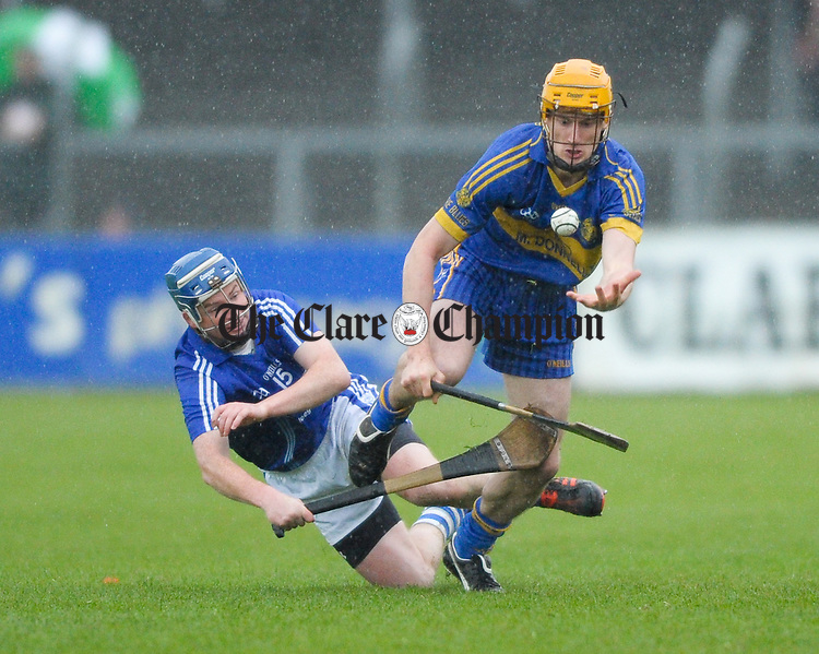 Gearoid Ryan of Cratloe in action against Alan Barrett of Newmarket On Fergus during the senior county hurling final at Cusack Park. Photograph by John Kelly.