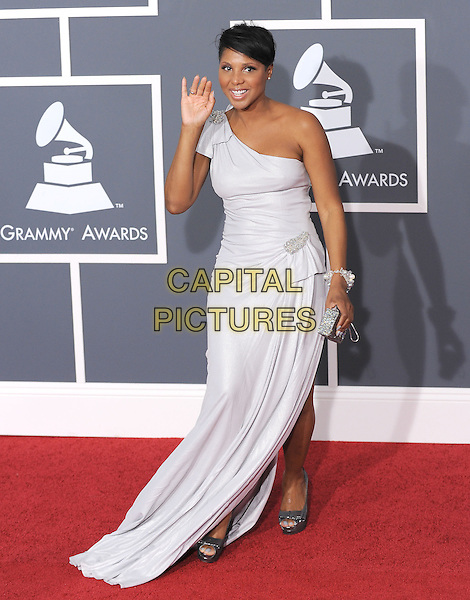TONI BRAXTON.Arrivals at the 52nd Annual GRAMMY Awards held at The Staples Center in Los Angeles, California, USA..January 31st, 2010.grammys full length white one shoulder dress slit spit hand palm waving .CAP/RKE/DVS.©DVS/RockinExposures/Capital Pictures