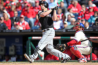 Miami Marlins outfielder Austin Kearns #26 hits a solo home run in the top of the ninth inning during a game against the Philadelphia Phillies at Citizens Bank Park on April 9, 2012 in Philadelphia, Pennsylvania.  Miami defeated Philadelphia 6-2.  (Mike Janes/Four Seam Images)