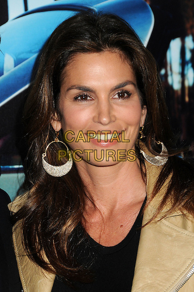 """CINDY CRAWFORD .HBO's """"His Way"""" Los Angeles Premiere held at Paramount Studios, Los Angeles, California, USA, 22nd March 2011..portrait headshot earrings gold black beige  leather beauty smiling .CAP/ADM/BP.©Byron Purvis/AdMedia/Capital Pictures."""