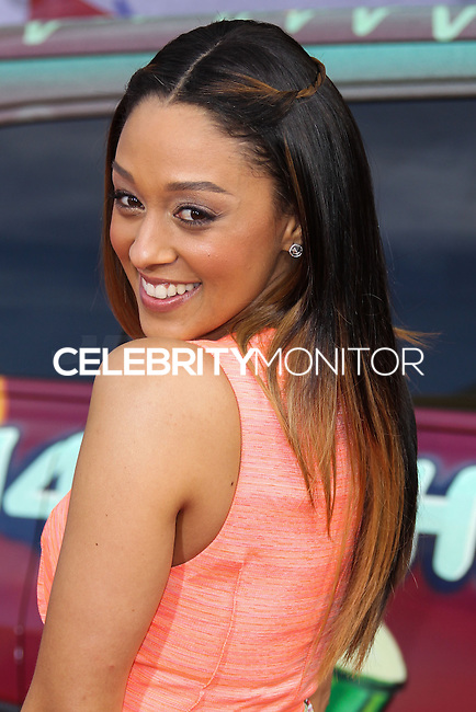 """HOLLYWOOD, LOS ANGELES, CA, USA - MARCH 11: Tia Mowry at the World Premiere Of Disney's """"Muppets Most Wanted"""" held at the El Capitan Theatre on March 11, 2014 in Hollywood, Los Angeles, California, United States. (Photo by Xavier Collin/Celebrity Monitor)"""