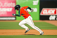 Alfredo Lopez (7) of the Greensboro Grasshoppers takes off for second base against the Delmarva Shorebirds at NewBridge Bank Park on May 26, 2013 in Greensboro, North Carolina.  The Grasshoppers defeated the Shorebirds 11-2.  (Brian Westerholt/Four Seam Images)