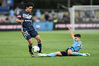17th November 2019; Jubilee Oval, Sydney, New South Wales, Australia; A League Football, Sydney Football Club versus Melbourne Victory; Paulo Retre of Sydney slides in to tackle Brandon Lauton of Melbourne Victory but is beaten