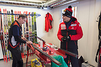 Switzerland. Canton Ticino. Swiss-Cups Campra. Cross Country Skiing. FIS Classic Sprint Race. Hippolyt Kempf (C) is the Cross Country Skiing Chef by Swiss-Ski. He stands in the technical area used by servicemen to prepare skis before the race. He talks a man working with a swiss german team. Hippolyt Kempf (born 10 December 1965) is a Swiss Nordic combined skier who competed during the late 1980s and early 1990s. He won a complete set of Olympic medals, earning two of them at the 1988 Winter Olympics in Calgary (gold: 15 km individual, silver: 3 x 10 km team) and the third at the 1994 Winter Olympics in Lillehammer (bronze: 3 x 10 km team). Kempf also earned a 3 x 10 km team silver medal at the 1989 FIS Nordic World Ski Championships in Lahti. Swiss-Ski is a branch of Swiss Olympic. The Fédération Internationale de Ski (FIS; English: International Ski Federation) is the world's highest governing body for international winter sports. Founded  on 2 February 1924, it is responsible for the Olympic disciplines of cross-country skiing. The FIS is also responsible for setting the international competition rules. 4.01.2020 © 2020 Didier Ruef