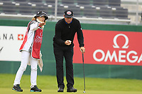 Scott Hend (AUS) and wife Leanne line up his birdie putt on the 18th green during Sunday's fog delayed Round 3 of the 2017 Omega European Masters held at Golf Club Crans-Sur-Sierre, Crans Montana, Switzerland. 10th September 2017.<br /> Picture: Eoin Clarke | Golffile<br /> <br /> <br /> All photos usage must carry mandatory copyright credit (&copy; Golffile | Eoin Clarke)