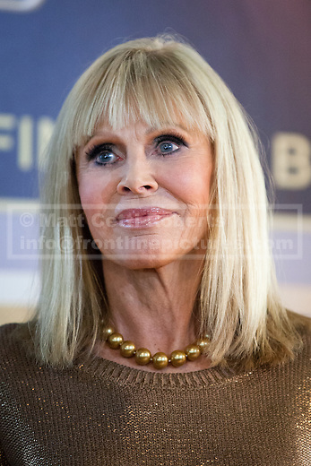 24/09/2012. LONDON, UK. Actress girl Britt Ekland, who played Bond Girl 'Goodnight' in 'The Man with the Golden Gun' is seen inside HMV's Oxford Street store in London, today (24/09/12) during a photocall. The stars were in London during the final leg of a UK tour to promote the Bond 50 Blu-Ray collection.  Photo credit: Matt Cetti-Roberts