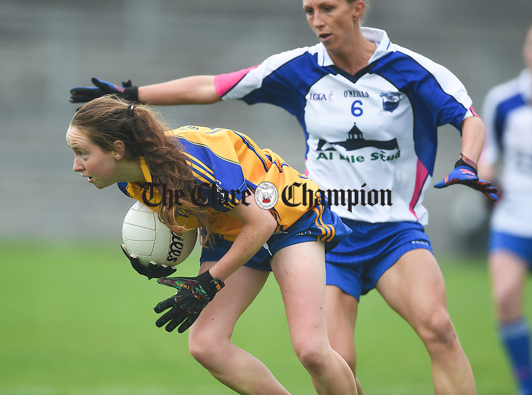 Roisin Howley of Clare in action against Elaine Power of Waterford during their Munster Intermediate Football final at Mallow. photograph by John Kelly.