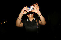CHINA. Beijing. A spectator taking pictures during the Beijing 2008 Summer Olympics. 2008