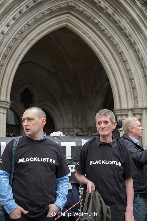 Blacklist Support Group celebrate outside the Royal Courts of Justice after victory in their campaign for compensation for  illegal blacklisting of construction workers.