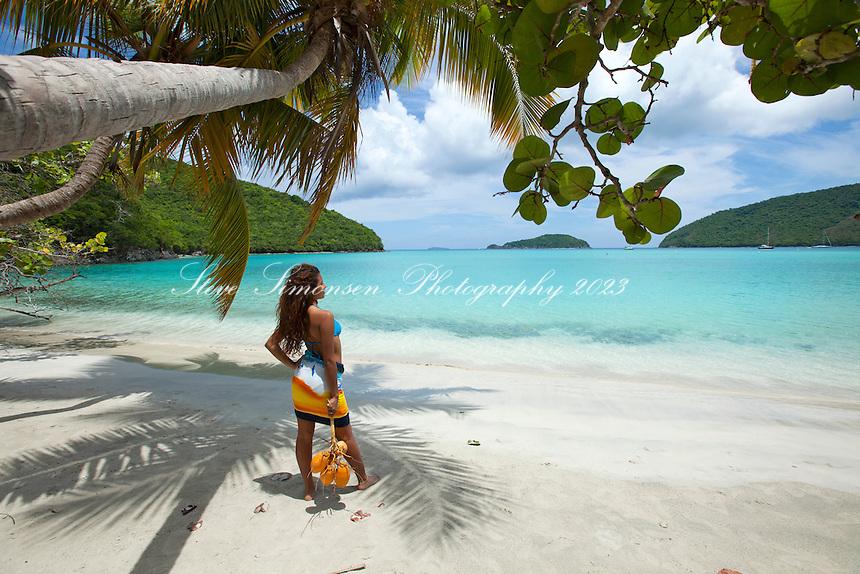 Aldris Santana with coconuts at Maho Bay.Virgin Islands National Park.St. John, U.S. Virgin Islands
