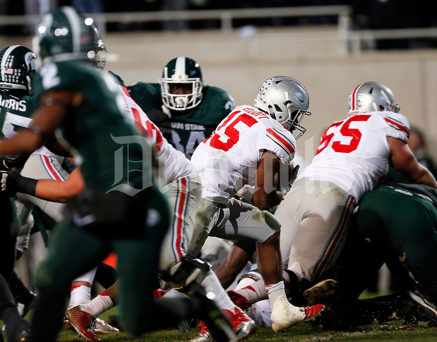 Ohio State Buckeyes running back Ezekiel Elliott (15) runs for a touchdown during the third quarter of the NCAA football game against the Michigan State Spartans at Spartan Stadium in East Lansing, Michigan on Nov. 8, 2014. (Adam Cairns / The Columbus Dispatch)