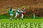 Ciara Kearney Kilcummin team breaks free from Helena HayesMilltown/Listry in the CCF Junior A final in Killarney on Sunday
