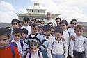 Iraq 2000<br /> Father Petros Harbol, Chaldean priest, with children in front the church of Levo<br /> Irak 2000<br /> Le p&egrave;re P&eacute;tros Harbol,pr&ecirc;tre chald&eacute;en,  entour&eacute; des enfants du village devant l'&eacute;glise de L&eacute;vo