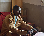 Emanuel Bizimungu a community health worker near Ruhunda Health Center, Rwanda in his living room where he receives patients. Emanuel focuses on the health of children aged five and under.  Diseases he treats include malaria, diarrhea, and children born with HIV.
