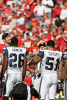 Jared Allen looks up at the coin toss prior to the game between the Seattle Seahawks and the Chiefs at Arrowhead Stadium  in Kansas City, Missouri on October 29, 2006.
