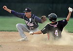SIOUX FALLS, SD - JULY 1:  Justin Kautz #17 from Sioux Falls Post 15 West, catches the ball as Nick Petersen #4 from Valley Springs tries to steal second in the sixth inning Monday night at Harmodon Park.  (Photo by Dave Eggen/Inertia)