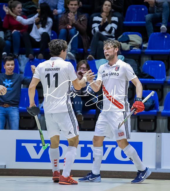 ROTTERDAM  - NK Zaalhockey . finale heren: SCHC-Amsterdam (2-2, SCHC wint shoot-outs) . Boris Burkhardt (Adam) met Robert Tigges na een doelpunt. .  COPYRIGHT KOEN SUYK