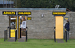 A groundsman putting up an admission price sign outside Shielfield Park, before the Scottish League Two fixture between Berwick Rangers and East Stirlingshire. The home club occupied a unique position in Scottish football as they are based in Berwick-upon-Tweed, which lies a few miles inside England. Berwick won the match by 5-0, watched by a crowd of 509.