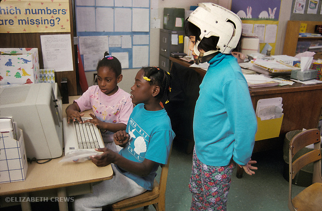 Oakland, Ca Students ages eight to ten working at computer in special day class for the learning handicapped