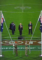 Australian and New Zealand flags are lowered to half-mast for the opening ceremony during the Australian Rules Football ANZAC Day match between St Kilda Saints and Sydney Swans at Westpac Stadium, Wellington, New Zealand on Thursday, 24 May 2013. Photo: Dave Lintott / lintottphoto.co.nz
