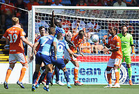 Blackpool's Paudie O'Connor heads clear despite the attentions of Wycombe Wanderers' Adebayo Akinfenwa<br /> <br /> Photographer Kevin Barnes/CameraSport<br /> <br /> The EFL Sky Bet League One - Wycombe Wanderers v Blackpool - Saturday 4th August 2018 - Adams Park - Wycombe<br /> <br /> World Copyright &copy; 2018 CameraSport. All rights reserved. 43 Linden Ave. Countesthorpe. Leicester. England. LE8 5PG - Tel: +44 (0) 116 277 4147 - admin@camerasport.com - www.camerasport.com