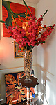 "Wine and champagne corks inside a glass vase holding her favorite flowers, gladiolus, in the dining room. Photo taken on January 8, 2019 for ""At Home"" feature on Sandy Stolberg, who uses dollar store finds as part of the decorations in her Belleville, IL condo.<br /> Photo by Tim Vizer"