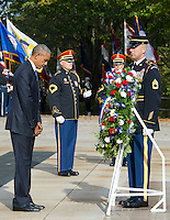 United States President Barack Obama bows his head in respect after laying a wreath during a ceremony at the Tomb of the Unknown Soldier at Arlington National Cemetery in Arlington, Virginia on Veteran's Day, Friday, November 11, 2016.  <br /> Credit: Ron Sachs / Pool via CNP /MediaPunch