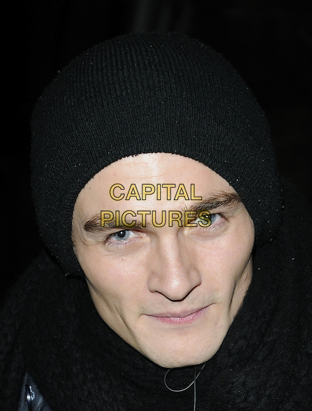 "RUPERT FRIEND.Leaving after the evening performance of ""The Little Dog Laughed"", The Garrick Theatre, London, England, UK, .8th March 2010,.portrait headshot black beanie hat scarf .CAP/CAN.©Can Nguyen/Capital Pictures"