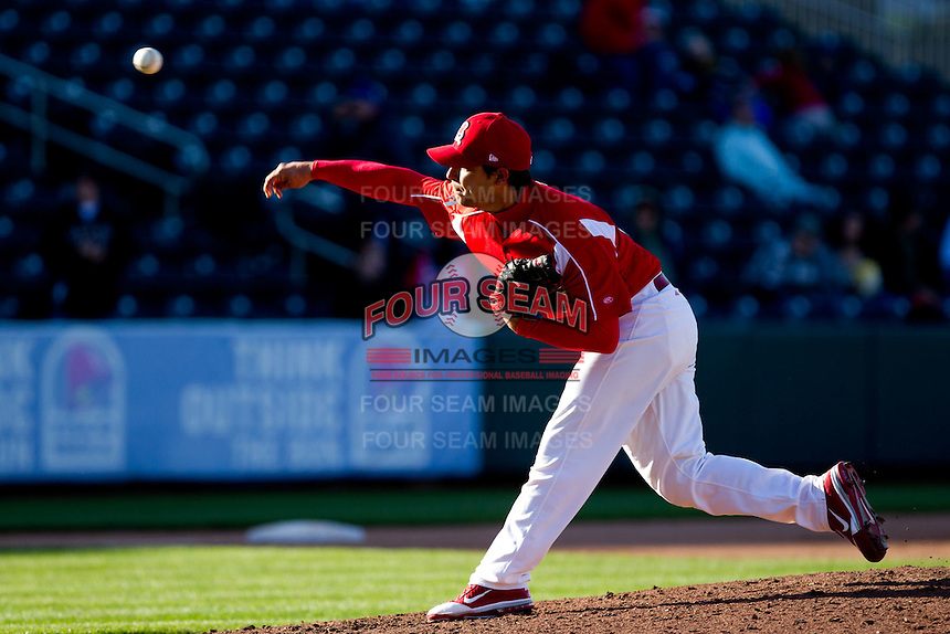 Richard Castillo (27) of the Springfield Cardinals delivers a pitch during a game against the Frisco RoughRiders on April 16, 2011 at Hammons Field in Springfield, Missouri.  Photo By David Welker/Four Seam Images