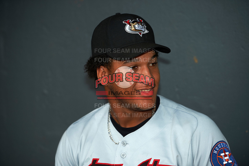 Tri-City ValleyCats third baseman Cesar Carrasco (9) in the dugout before a game against the Aberdeen Ironbirds on August 6, 2015 at Ripken Stadium in Aberdeen, Maryland.  Tri-City defeated Aberdeen 5-0 in a combined no-hitter.  (Mike Janes/Four Seam Images)