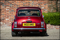 BNPS.co.uk (01202 558833)<br /> Pic: Silverstone/BNPS<br /> <br /> Mini Bar - A 'funky' Mini Cooper that comes complete with its own disco ball and drinks bar is to be sold at auction by Jamiroquai singer Jay Kay.<br /> <br /> Affectionately nicknamed 'Chuckles' by the star, the Cooper Sport has been given a complete overhaul and is now completely unique.<br /> <br /> It has been fitted with plush velvet curtains and a bespoke red leather interior to go with a multicoloured disco light located on the cabin ceiling.