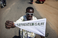 A motorcyclist holds a pendant with the slogan Separation is Life written on it in anticipation of the South Sudan independence referendum scheduled for January 2011.