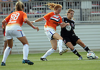 BOYDS, MARYLAND - July 22, 2012:  Ashley Herndon (19) of DC United Women passes the ball away from Sarah Ann Waugh (3) of the Charlotte Lady Eagles during the W League Eastern Conference Championship match at Maryland Soccerplex, in Boyds, Maryland on July 22. DC United Women won 3-0.