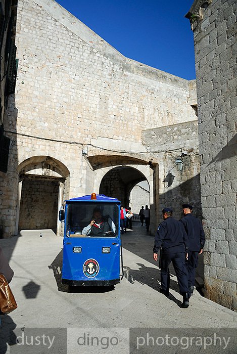 Small electric vehicle and two policemen, Dubrovnik old town, Croatia