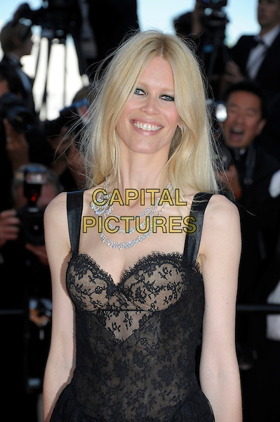 CLAUDIA SCHIFFER.'This Must be the Place' premiere during the 64th International Cannes Film Festival, France, 20th May 2011..half length dress eyeliner make-up  beauty diamond necklace flower  black lace sheer see thru through bustier smiling .CAP/PL.©Phil Loftus/Capital Pictures.