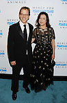 WEST HOLLYWOOD, CA- SEPTEMBER 12: Professional poker player Phil Laak (L) and actress Jennifer Tilly attend Mercy For Animals 15th Anniversary Gala at The London on September 12, 2014 in West Hollywood, California.
