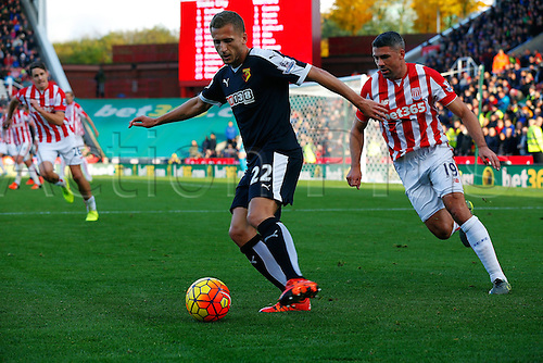 24.10.2015. Britannia Stadium, Stoke, England. Barclays Premier League. Stoke versus Watford. Goal Scorer Almen Abdi of Watford is watched by Jonathan Walters of Stoke City