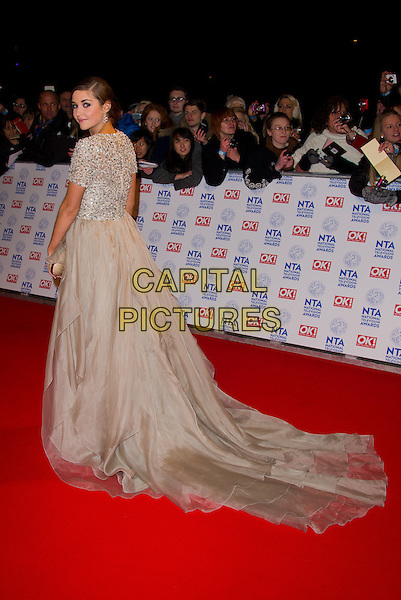 Jacqueline Jossa .National Television Awards at the 02 Arena, London, England. .January 23rd, 2013.NTA NTAs full length dress  beige silver beads beaded train back behind rear looking over shoulder .CAP/CJ.©Chris Joseph/Capital Pictures.