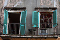 French Quarter, New Orleans, Louisiana.  Balcony with Windows and Beaded Necklace Decorations.