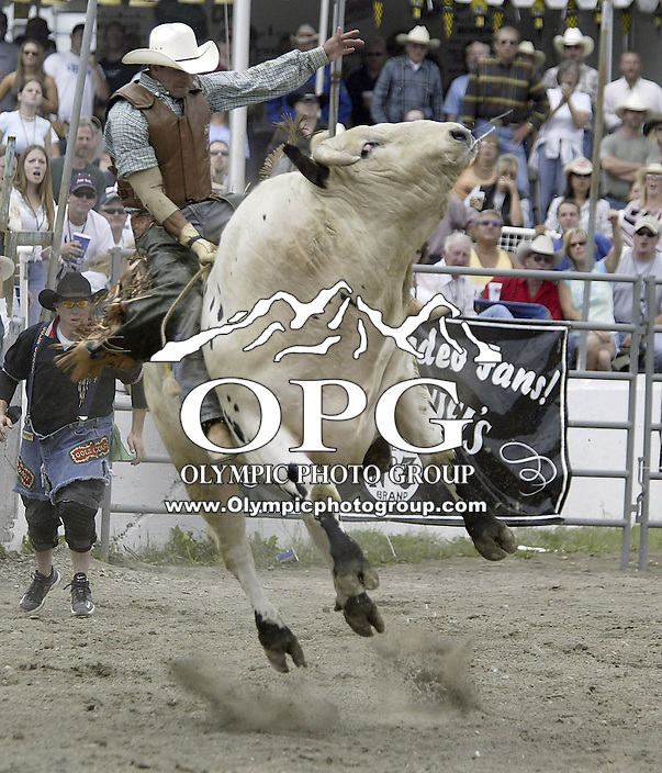 """29 Aug 2004: PRCA Rodeo Bull Rider Myron Duarte ranked 5th in the world riding the bull """"Close Call""""  during the PRCA 2004 Extreme Bulls competition in Bremerton, WA. Myron won the overall competition with a combined score of 176."""