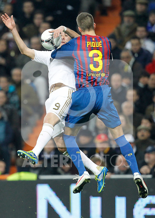 Real Madrid's Karim Benzema and FC Barcelona's Gerard Pique during spanish King's Cup on January 18th 2012...Photo: Cesar Cebolla / ALFAQUI