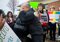 NWA Democrat-Gazette/JASON IVESTER<br /> Jose Aristondo gets a hug from Stephanie Red of Bentonville after Aristondo and his wife Amanda went in the Immigration and Customs Enforcement office in Fayetteville.
