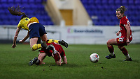 13th February 2020; Deva Stadium, Chester, Cheshire, England; Womens Super League Football, Liverpool Womens versus Arsenal Womens;  Lisa Evans of Arsenal Women flies over the tackle from a Liverpool defender in the box as Becky Jane of Liverpool cleans up