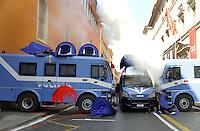 Roma, 11 Marzo 2011.Sciopero e corteo del sindacato autonomo Unione Sindacale di Base.Lancio di uova , vernice e petardi verso la polizia schierata davanti il Senato e tende da campeggio in strada e sui blindati