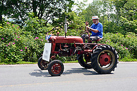 A 1948 Farmall tractor joins an Independance day Parade in Vermont, USA