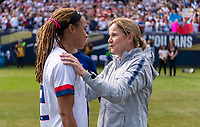 CHICAGO, IL - OCTOBER 6: Jill Ellis of the United States talks to Jess McDonald #22 during a game between Korea Republic and USWNT at Soldier Field on October 6, 2019 in Chicago, Illinois.
