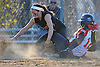 Nicole Farese #1, Sayville shortstop, left, tags out Angela Bukofsky #12 of Mount Sinai at third base in the bottom of the fourth inning of a non-league varsity softball game at Mount Sinai High School on Wednesday, Apr. 13, 2016. Mount Sinai won by a score of 10-9.