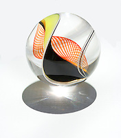 Colorful black, yellow, and orange glass marble