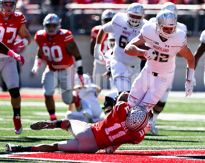 Maryland Terrapins tight end Avery Edwards (82) reaches for extra yardage as Ohio State Buckeyes safety Vonn Bell (11) brings him down during the third quarter of a NCAA college football game between the Ohio State Buckeyes and the Maryland Terrapins on Saturday, October 10, 2015 at Ohio Stadium in Columbus, Ohio. (Joshua A. Bickel/The Columbus Dispatch)