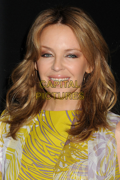 Kylie Minogue.Roc Nation 2013 Pre-Grammy Brunch held at Soho house, West Hollywood, California, USA, .9th February 2013..portrait headshot yellow white print  wavy hair gold hoop earrings smiling beauty make-up  .CAP/ADM/BP.©Byron Purvis/AdMedia/Capital Pictures.